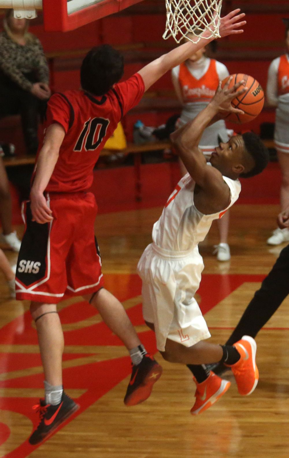 Lanphier's Jayden Collins goes airborne while putting up two points in the second half. David Spencer/The State Journal Register