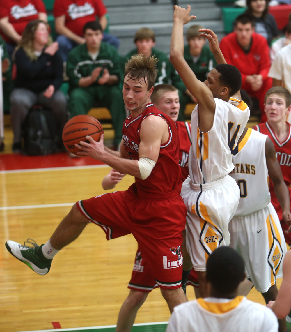Lincoln player Aron Hopp snags a rebound in the first half. David Spencer/The State Journal Register