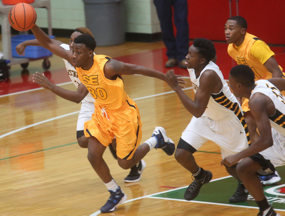 Southeast player D'Angelo Hughes keeps control of the ball as he sprints downcourt during first half action. David Spencer/The State Journal Register