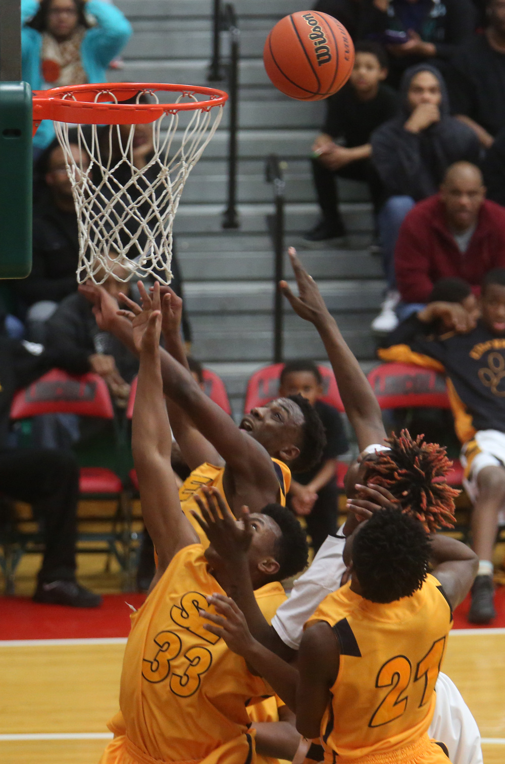 Southeast players go up for a rebound. David Spencer/The State Journal Register