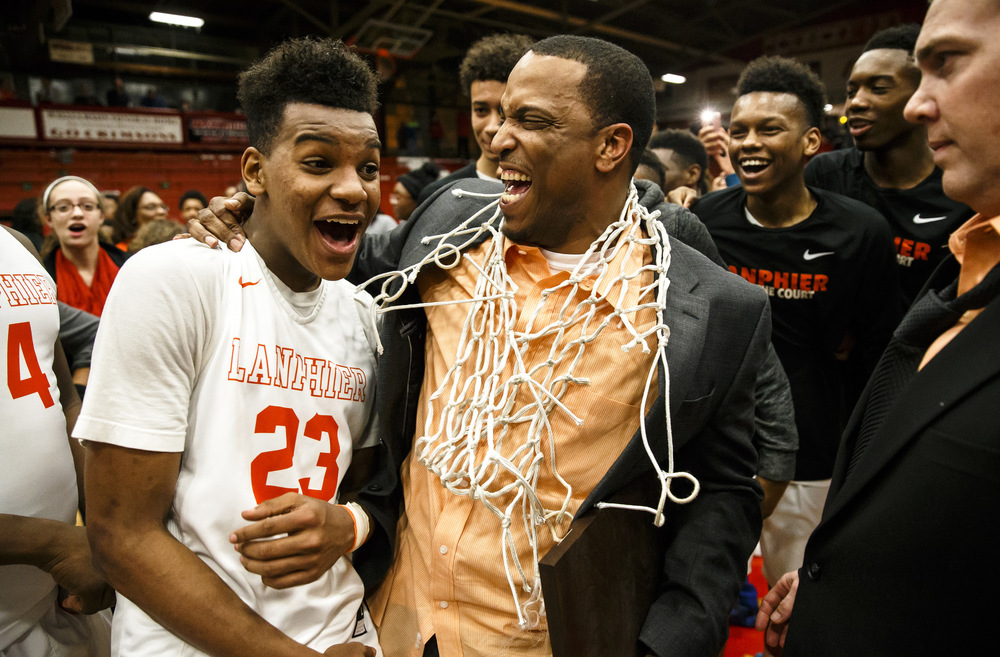 Lanphier head basketball coach Blake Turner celebrates with Lanphier's Aundrae Williams (23) after making it to the court after the Lions defeated Jacksonville 76-64 during the Class 3A Jacksonville Regional championship game at the Jacksonville Bowl, Friday, March 4, 2016, in Jacksonville, Ill. Justin L. Fowler/The State Journal-Register