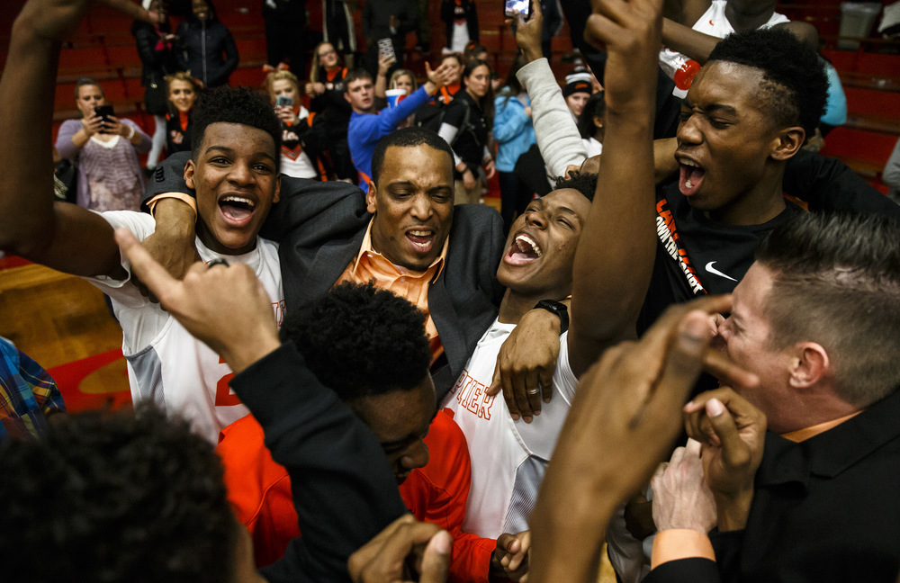 Lanphier head basketball coach Blake Turner celebrates with his team after the Lions defeated Jacksonville 76-64 in the Class 3A Jacksonville Regional championship game at the Jacksonville Bowl, Friday, March 4, 2016, in Jacksonville, Ill. Justin L. Fowler/The State Journal-Register