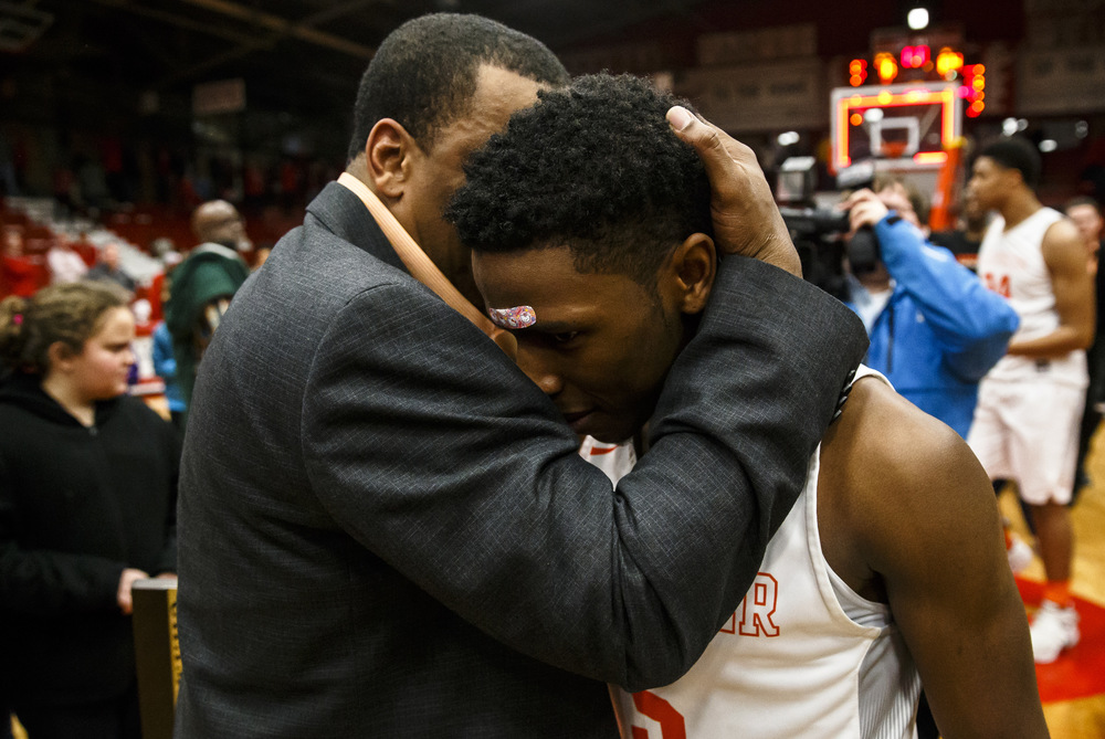 Lanphier head basketball coach Blake Turner hugs Lanphier's Xavier Bishop (5) after making his way to the court after the Lions 74-64 win over Jacksonville in the Class 3A Jacksonville Regional championship game at the Jacksonville Bowl, Friday, March 4, 2016, in Jacksonville, Ill. Justin L. Fowler/The State Journal-Register