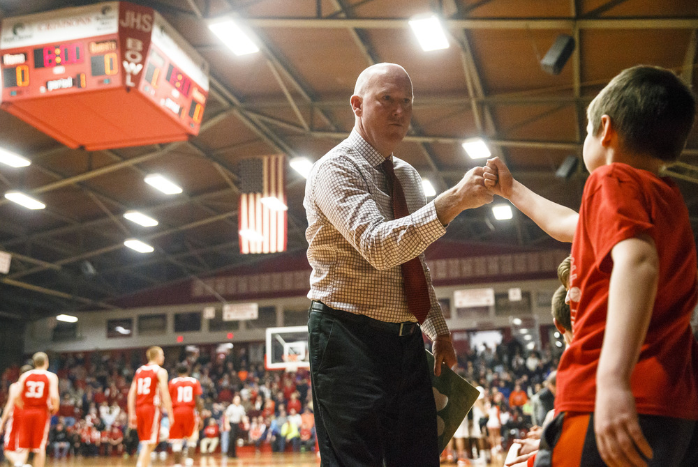 Jacksonville head coach Sean Taylor gets a fist bump prior to tip-off against Lanphier in the Class 3A Jacksonville Regional championship game at the Jacksonville Bowl, Friday, March 4, 2016, in Jacksonville, Ill. Justin L. Fowler/The State Journal-Register