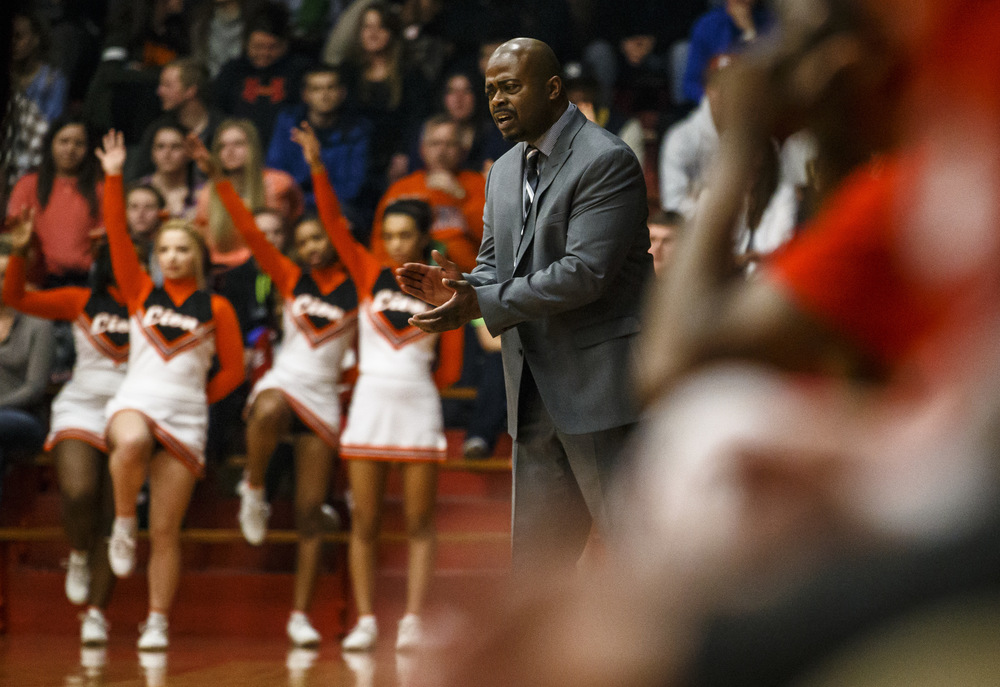Acting Lanphier boys basketball head coach Felipe Phillips cheers on the Lions as they take on Jacksonville in the first quarter during the Class 3A Jacksonville Regional championship game at the Jacksonville Bowl, Friday, March 4, 2016, in Jacksonville, Ill. Justin L. Fowler/The State Journal-Register