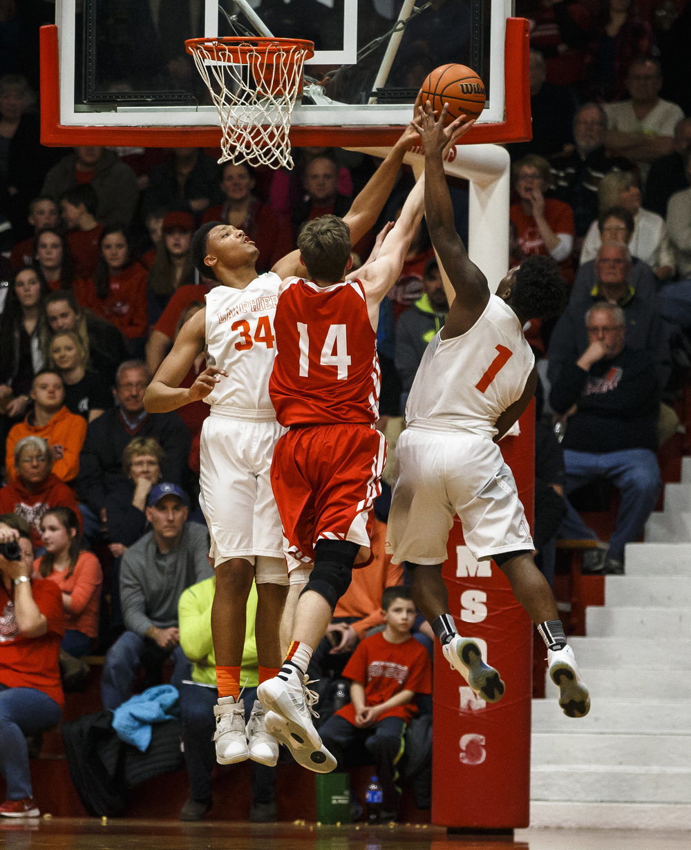 Lanphier's Davon Higgerson-Harris (34) blocks a shot from Jacksonville's Riley Dugan (14) in the second quarter during the Class 3A Jacksonville Regional championship game at the Jacksonville Bowl, Friday, March 4, 2016, in Jacksonville, Ill. Justin L. Fowler/The State Journal-Register