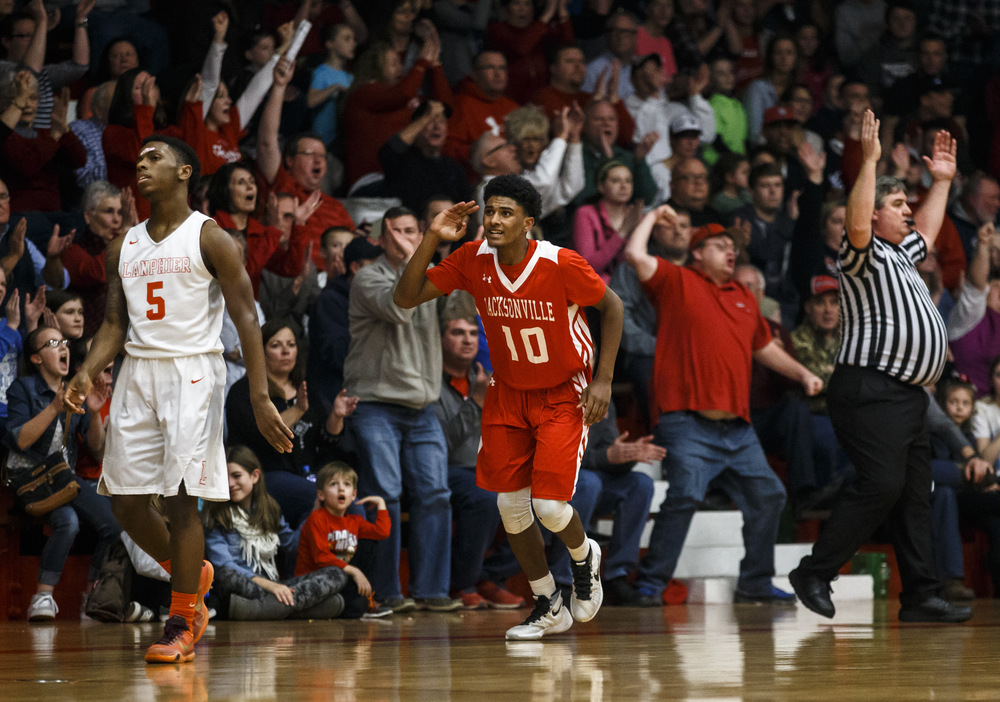 Jacksonville's James White (10) reacts after hitting a 3-pointer against Lanphier's Xavier Bishop (5) in the second quarter during the Class 3A Jacksonville Regional championship game at the Jacksonville Bowl, Friday, March 4, 2016, in Jacksonville, Ill. Justin L. Fowler/The State Journal-Register