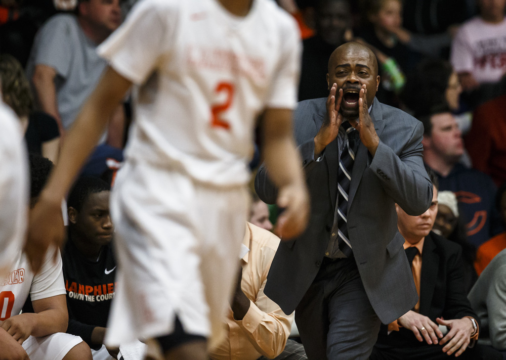 Acting Lanphier boys basketball head coach Felipe Phillips calls out instructions to his players as they take on Jacksonville in the third quarter during the Class 3A Jacksonville Regional championship game at the Jacksonville Bowl, Friday, March 4, 2016, in Jacksonville, Ill. Justin L. Fowler/The State Journal-Register
