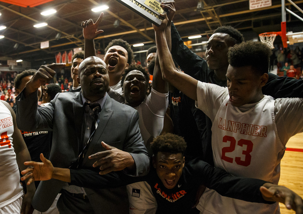 Acting Lanpheir boys basketball head coach Felipe Phillips celebrates with the Lions after their 76-64 victory over Jacksonville in the Class 3A Jacksonville Regional championship game at the Jacksonville Bowl, Friday, March 4, 2016, in Jacksonville, Ill. Justin L. Fowler/The State Journal-Register