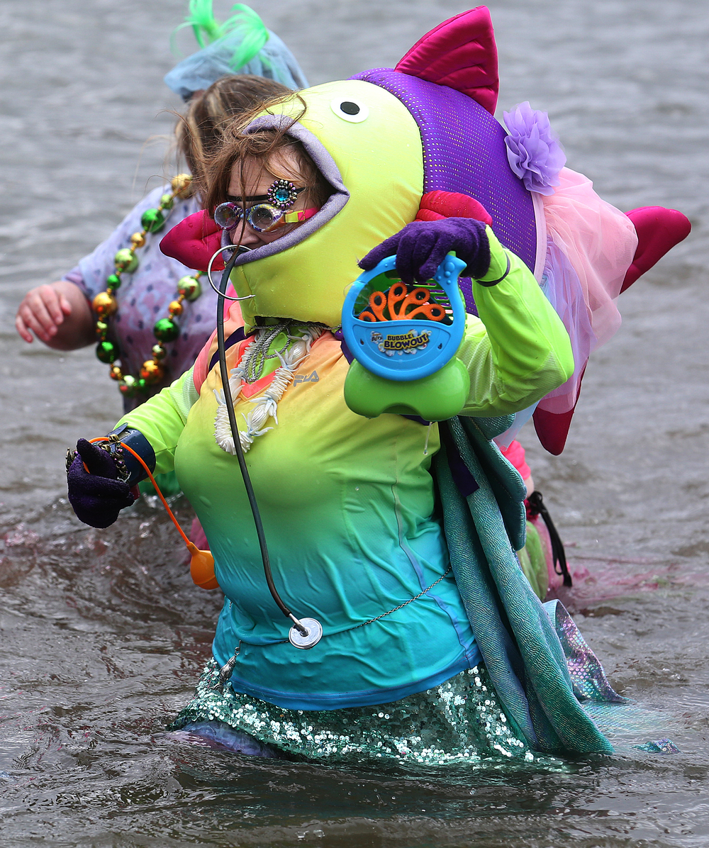 Saying she was a nurse shark, real life nurse Joan Swaar, a member of the SIU School of Medicine Polar Plunge team made up of nurses and doctors, holds up a soap bubble machine she took into the frigid water of Lake Springfield Saturday. David Spencer/The State Journal Register