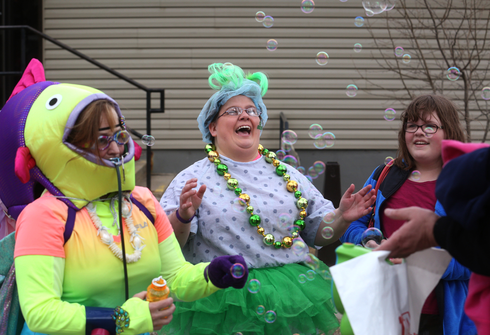 SIU School of Medicine Polar Plunge team member Sam Smith at center, a nurse in real life, has fun with bubbles before the start of the plunge. David Spencer/The State Journal Register