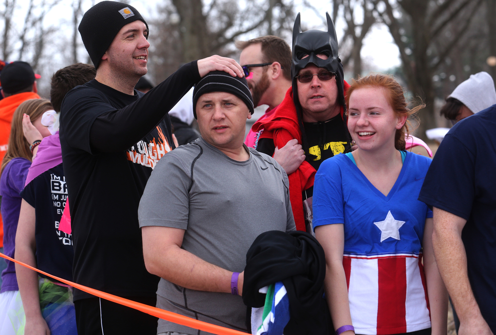 Some of the first plungers line up moments before taking to the frigid waters of Lake Springfield Saturday. David Spencer/The State Journal Register