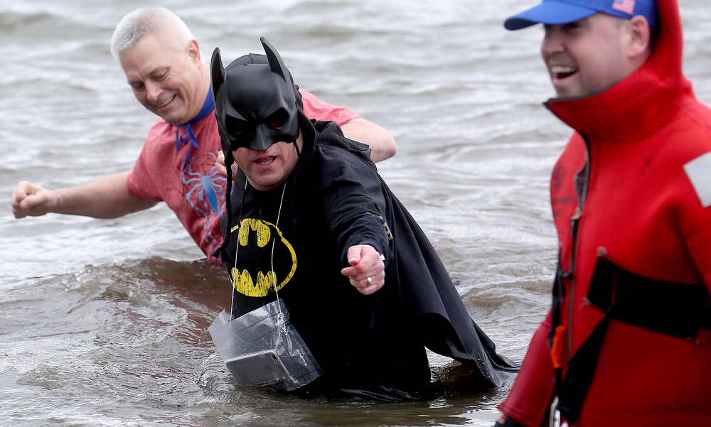 Batman made the plunge Saturday, and carried his iPhone in a waterproof bag just in case the need to call arose during the trip. David Spencer/The State Journal Register