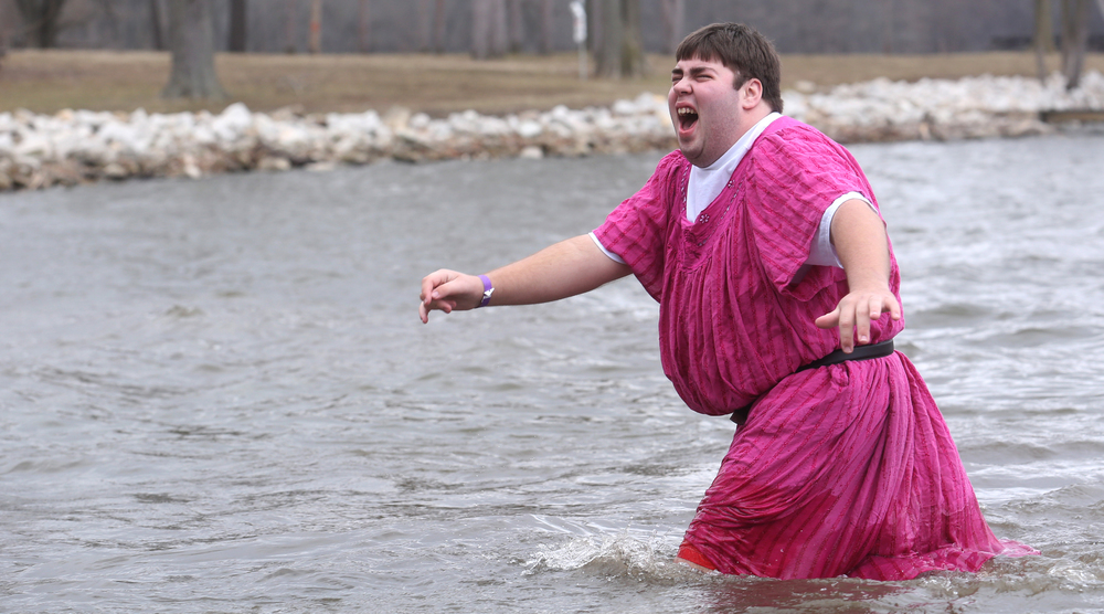 A pink dress worn over a tee-shirt by one plunger didn't seem to ward off the effects of the frigid waters of Lake Springfield. David Spencer/The State Journal Register