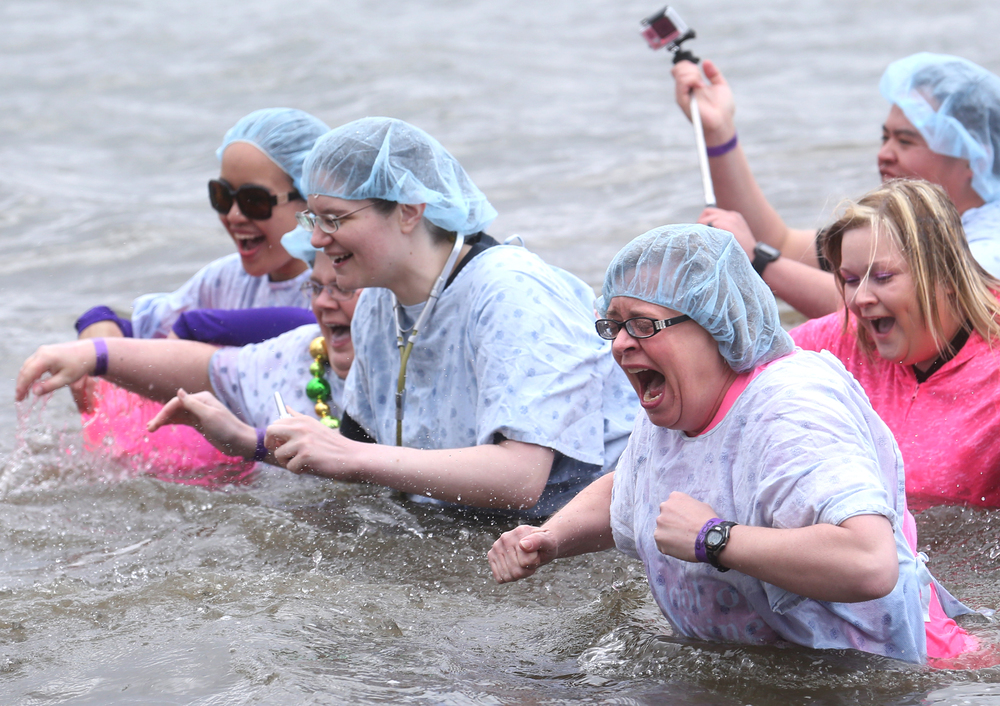 Nurses and other medical pros making up a Polar Plunge team from the SIU School of Medicine make their back to dry land. David Spencer/The State Journal Register