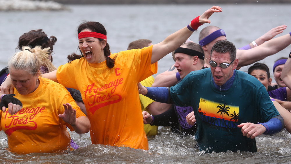 Members of the plunge team Average Joe's-who appeared in the movie DodgeBall- make their way back to dry land Saturday. David Spencer/The State Journal Register