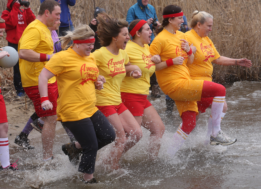 Members of the plunge team Average Joe's-who appeared in the movie DodgeBall- lock arms and make the dash together into Lake Springfield. David Spencer/The State Journal Register