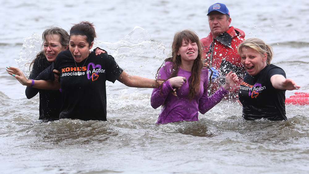 A Polar Plunge team from Kohl's department store make their way back to dry land Saturday. David Spencer/The State Journal Register