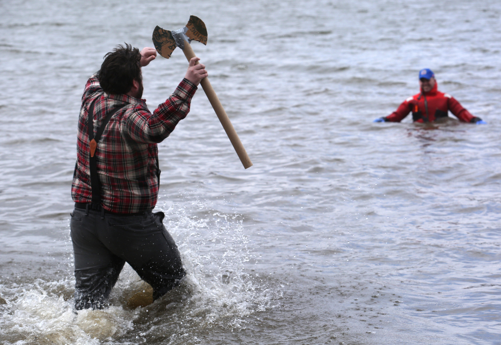 Paul Bunyan: aka: Cyrus Winnett of Springfield- who brought his cardboard axe along, had the distinction of being the final plunger on Saturday. Springfield firefighter Tyler Sitko, wearing a protective dry suit, can be seen at right in distance. David Spencer/The State Journal Register