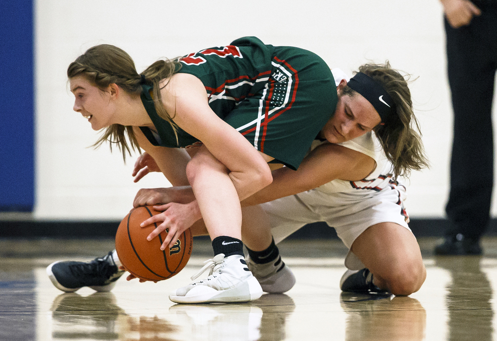 Lincoln's Hannah Cameron (21) and Highland's Alex LaPorta (13) go for a loose ball in the second quarter during the Class 3A UIS Supersectional at The Recreation and Athletic Center on the UIS campus, Monday, Feb. 29, 2016, in Springfield, Ill. Justin L. Fowler/The State Journal-Register