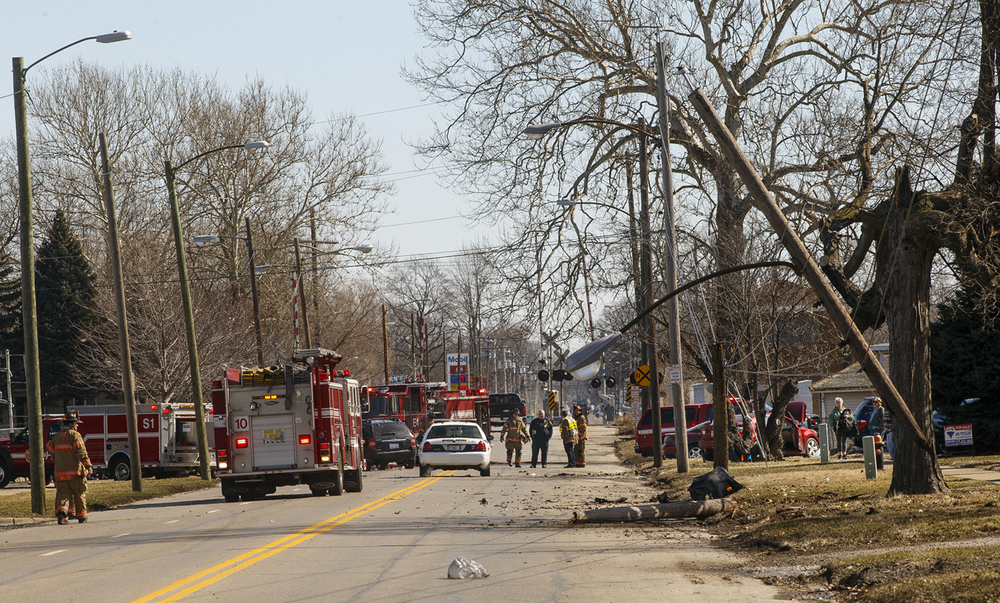Springfield rescue officials responded to the scene of an accident on North Grand Avenue where an eastbound vehicle crashed through two power poles and hit another car before coming to a rest before Robin Roberts Stadium Wednesday, March 3, 2016. Ted Schurter/The State Journal-Register