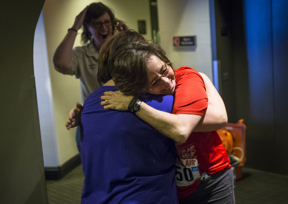 "Debbie Stoneburner, center, gets a hug from Lori Younker, a program director with the American Lung Association, after climbing the 32 flights of stairs during the Fight for Air Climb at Wyndham Springfield City Centre, Sunday, Feb. 21, 2016, in Springfield, Ill. Stoneburner was climbing in honor of her late husband, Blair Stoneburner, who passed away five years go from Idiopathic Pulmonary Fibrosis. ""It's important to me,"" said Stoneburner of her seventh time making the climb. ""I just think it's a good cause."" Justin L. Fowler/The State Journal-Register"