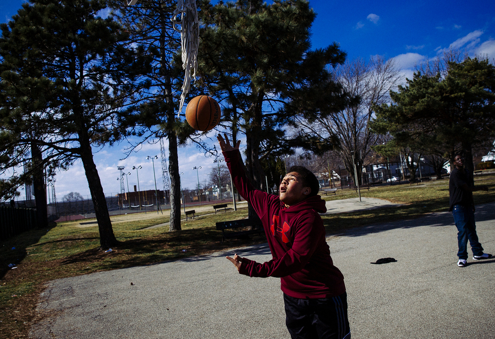 Iverson Miles, 13, takes advantage of the spring like temperatures with some pick-up basketball at Lanphier Park, Sunday, Feb. 21, 2016, in Springfield, Ill. Though not as warm was as the record breaking high of 71 set on Saturday, the Springfield area enjoyed another day of warmer than normal temperatures. Justin L. Fowler/The State Journal-Register