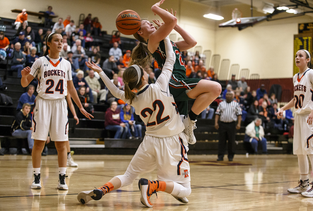 Lincoln's Hannah Cameron (21) takes a shot to the face from Rochester's Maddie Unser (22) as she tries to go up for a shot underneath the basket in the second quarter during the Class 3A Clinton Sectional semifinals at Clinton High School, Monday, Feb. 22, 2016, in Clinton, Ill. Justin L. Fowler/The State Journal-Register