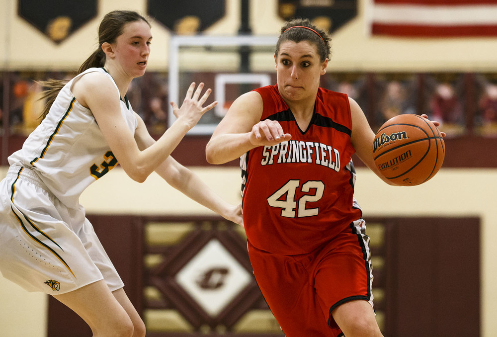 Springfield's Nicole Swehla (42) drives to the basket against Champaign St. Thomas More's Alex Specht (30) in the fourth quarter during the Class 3A Clinton Sectional semifinals at Clinton High School, Monday, Feb. 22, 2016, in Clinton, Ill. Justin L. Fowler/The State Journal-Register