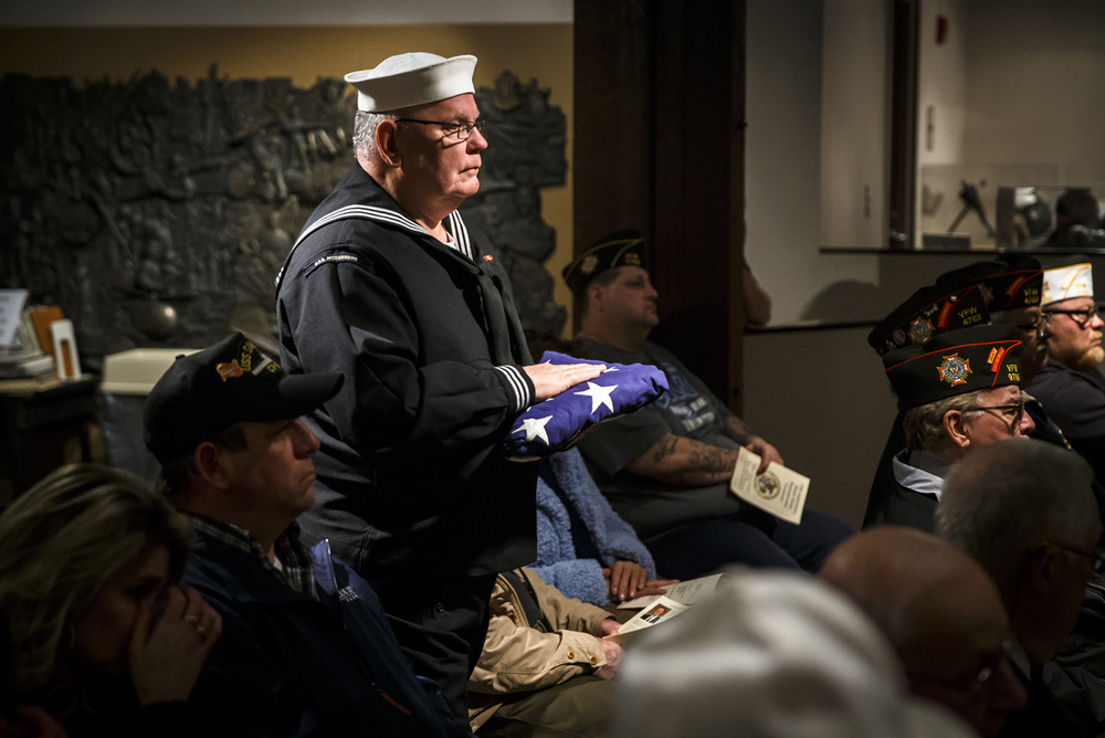 Don Ferricks, a Navy and Air Force Veteran, carries the American Flag as the last piece in the memorial service presented by the Living History Detachment during the 25th annual Desert Storm Remembrance Ceremony hosted by the Illinois Department of Veterans Affairs at the Illinois Military Museum, Sunday, Feb. 28, 2016, in Springfield, Ill. The day marked the 25th anniversary of the cease-fire for Operation Desert Storm. Justin L. Fowler/The State Journal-Register