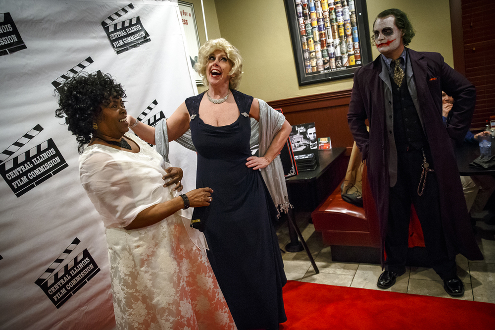 Laura Richter, center, as Marilyn Monroe, poses for pictures with Sherry Pittman, left, former treasurer of the Central Illinois Film Commission, while the Joker, played by Cris Ryan Taylor, right, waits to join in during the Central Illinois Film Commission's annual Academy Awards Red Carpet Party at The Dublin Pub, Sunday, Feb. 28, 2016, in Springfield, Ill. Justin L. Fowler/The State Journal-Register