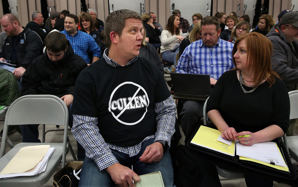 "Wearing a tee-shirt showing his displeasure for North Mac Superintendent Marica Cullen, group spokesman Dave Harmon of Thayer has a chat with group member and school parent Jodi Baker at right while they wait with about 100 people in the multi-purpose room at the South Campus for the district during the closed session part of the board meeting Wednesday night. At left on empty chair are copies of the petition signatures that were turned in. The group North Mac Citizens for Vote of No Confidence presented a signed petition of no confidence in the leadership skills of School District Superintendent Marica Cullen to the school board at its meeting at district offices in Girard on Wednesday evening, Feb. 24, 2016. Group spokesman Dave Harmon said about 600 people have signed the petition in the past three weeks with the petition alleging Cullen- a former administrator at Lanphier High School in Springfield- ""fails to provide for the safety of the district children, creates and fosters a mistrustful, micromanaged, abusive work environment and lacks adequate communication skills with North Mac patrons."" David Spencer/The State Journal Register"