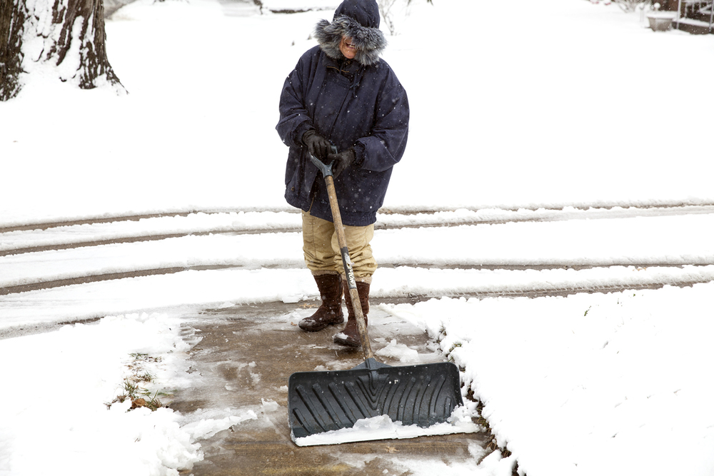 "C.J. Dart didn't think the weather was too bad for her to get out and shovel her driveway and the sidewalk in front of her home on South Lowell Ave. Wednesday, Feb. 24, 2016. ""It's my exercise,""  she said. Rich Saal/The State Journal-Register"