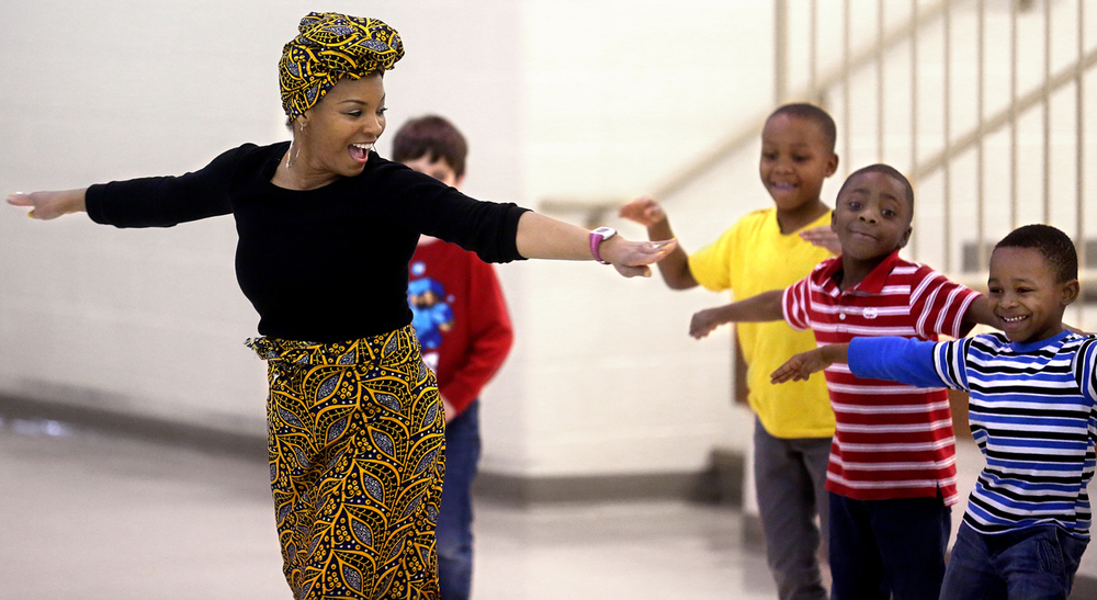 Alkynessa Miller, an instructor at Pixie Power Fitness in Springfield, demonstrates African dancing in the multi-purpose room of the school Friday while joined by a group of students who put on some moves of their own while traditional African music was played. As part of black history month, Springfield's Lindsay Elementary held several assemblies for students K-5 at the school on Friday, Feb. 26, 2016 featuring African dancing as well as an Omega Psi Phi fraternity step show. David Spencer/The State Journal Register