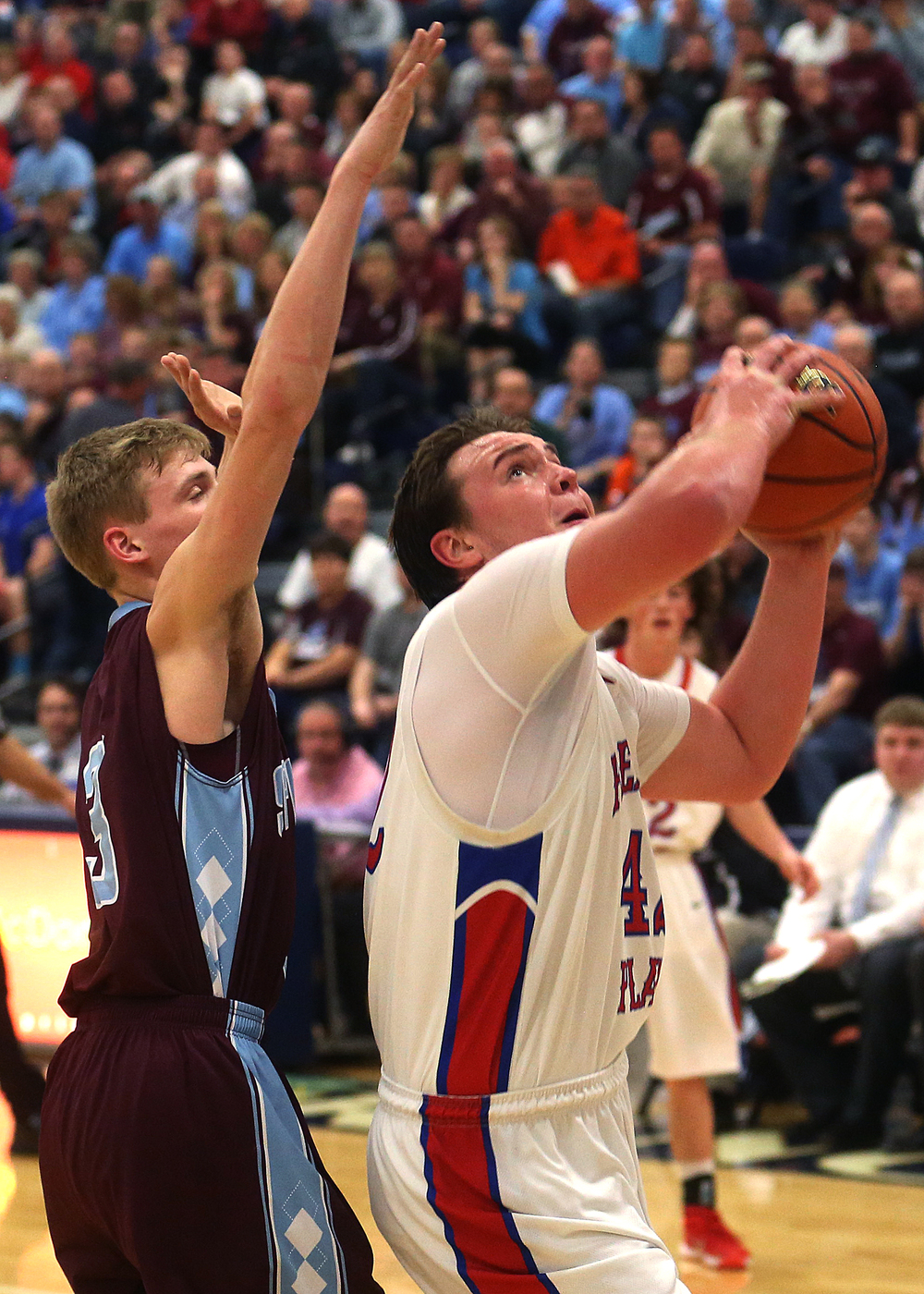 Pleasant Plains player Nik Clemens puts up a first half shot while being defended by St. Joseph-Ogden player Brandon Trimble. David Spencer/The State Journal Register