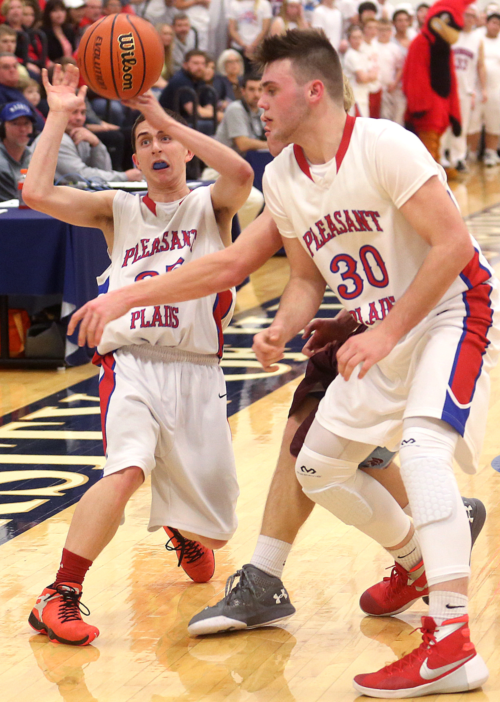 Pleasant Plains player Isaac Collins tries to get off a pass during the first half. David Spencer/The State Journal Register