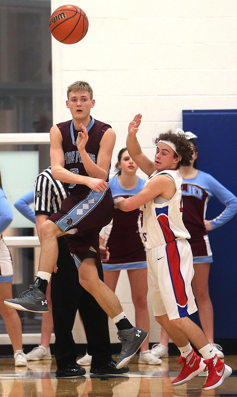 St. Joseph-Ogden player Brandon Trimble whips a pass downcourt. David Spencer/The State Journal Register