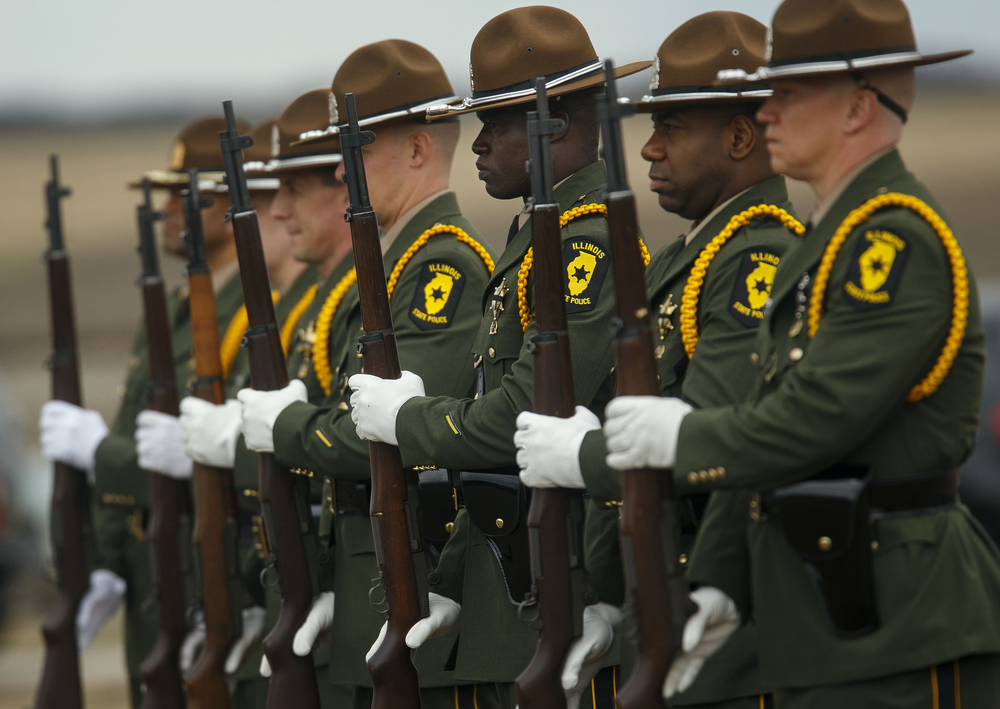 The Illinois State Police Honor Guard stands at attention during graveside funeral services for South Jacksonville Police Officer Francis Scot Fitzgerald at the Murrayville Village Cemetery Wednesday, March 9, 2016. Officer Fitzgerald was killed in a car accident while on duty last week.  Ted Schurter/The State Journal-Register