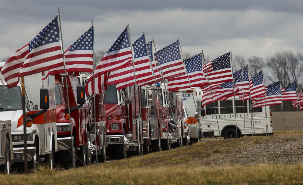 Flags and emergency vehicles line the parking lot of First Christian Church in South Jacksonville during funeral services for South Jacksonville Police Officer Francis Scot Fitzgerald Wednesday, March 9, 2016. Officer Fitzgerald was killed in a car accident while on duty last week. Ted Schurter/The State Journal-Register