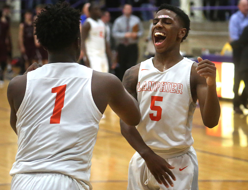 Lanphier's Xavier Bishop at right celebrates the win at the end of the game with teammate Yaakema Rose. David Spencer/The State Journal Register