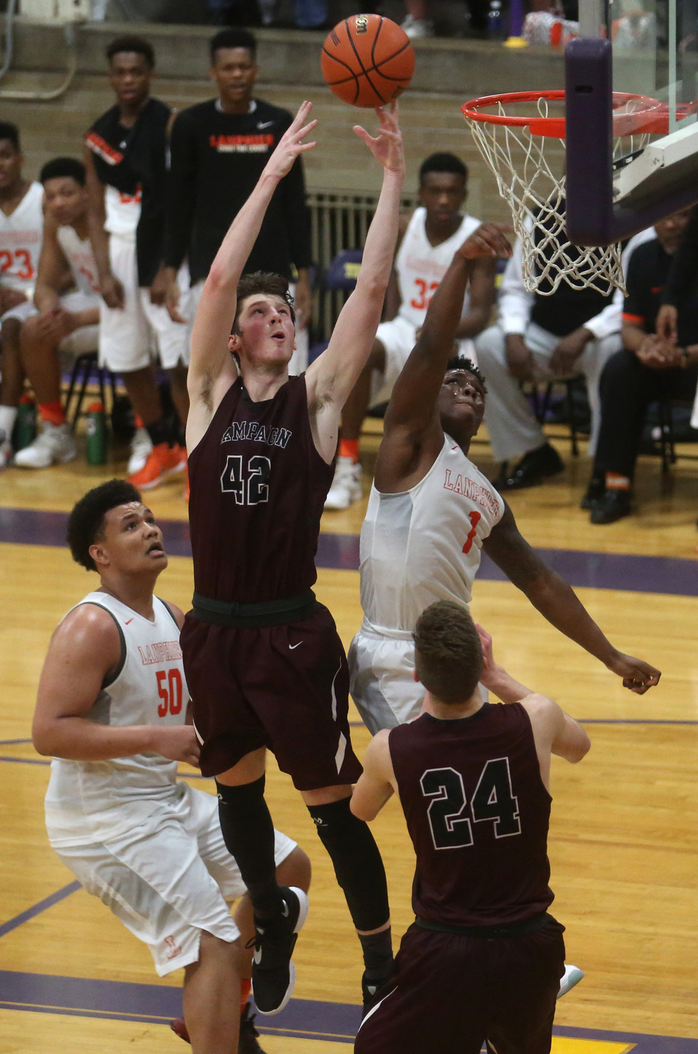 Champaign Central's Nick Finke used his height advantage to grabe this rebound late in the game while Lanphier's Yaakema Rose also goes up for it at right.David Spencer/The State Journal Register
