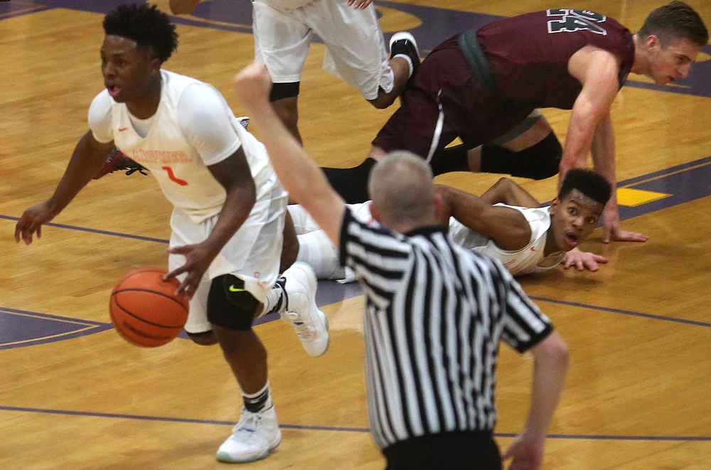 Lanphier's Aundrae Williams looks to the referee after after passing off the ball to teammate Yaakema Rose at left. David Spencer/The State Journal Register
