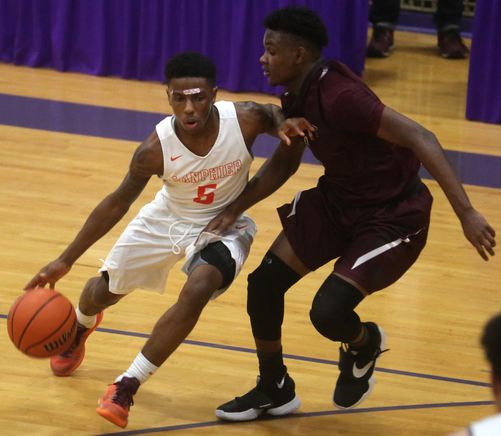 Lanphier's Xavier Bishop drives around Champaign Central defender Bailey Dee. David Spencer/The State Journal Register