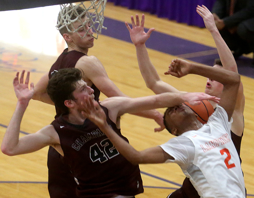 Lanphier player Cardell McGee is fouled late in the game by Champaign Central defender Nick Finke at left. David Spencer/The State Journal Register