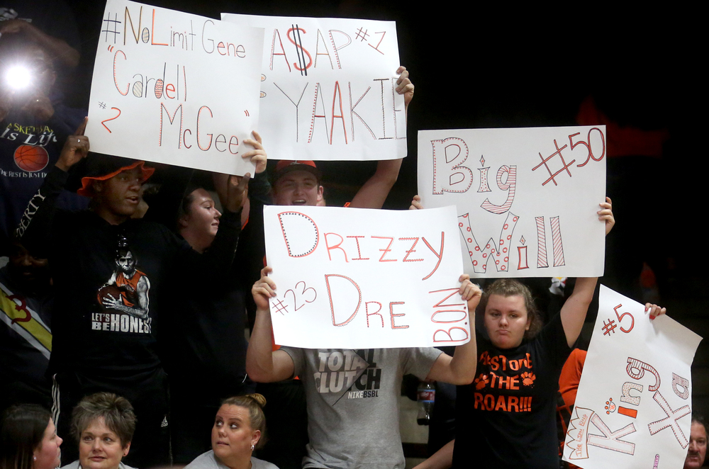 Lanphier fans in the stands hold up signs supporting members of the starting team after the Lions clinched a victory Wednesday night. David Spencer/The State Journal Register