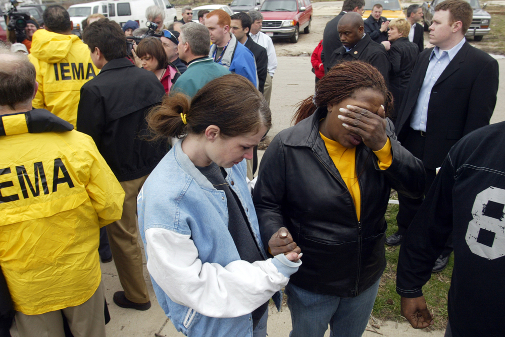 Patricia Martin, center, wipes tears from her eyes as her friend Christine Hysler consoles her after she spoke to Gov. Rod Blagojevich, left, and members of the media in Springfield. Martin's house was damaged by a tornado that destroyed several homes and businesses across Springfield March 12, 2006. Ted Schurter/The State Journal-Register