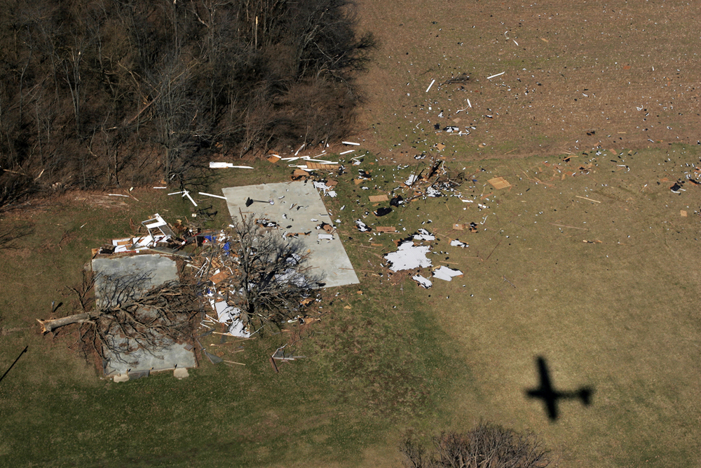 The remains of a property near Barrow, Ill are strewn across a field. Ted Schurter/The State Journal-Register