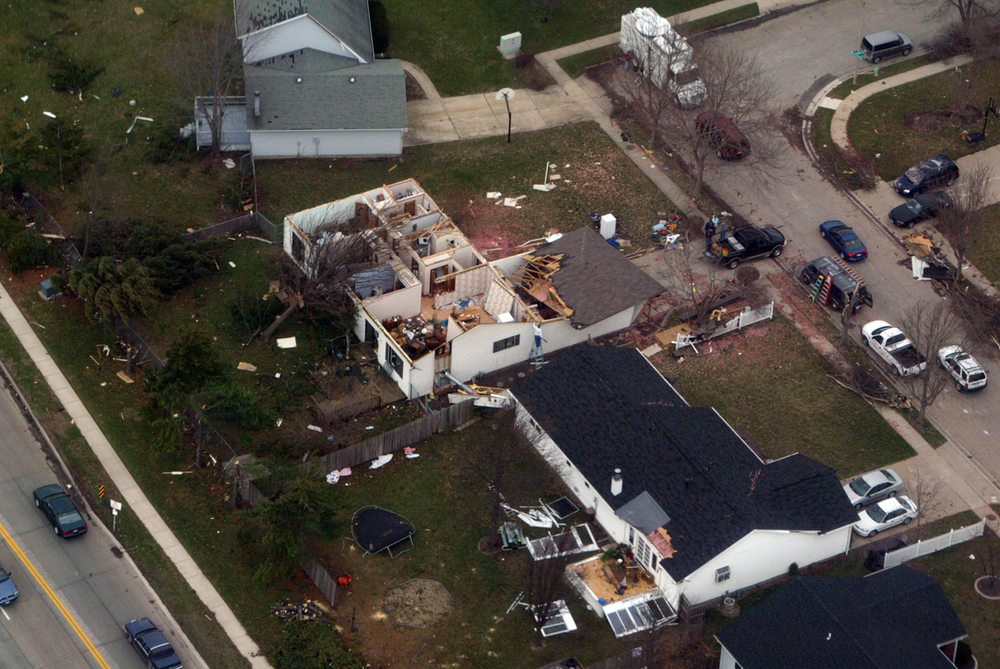 The home of Dana and Pat Kuster, 2624 Manchester Blvd., lost its roof during a tornado that destroyed several homes in Springfield March 12, 2006. Ted Schuter/The State Journal-Register