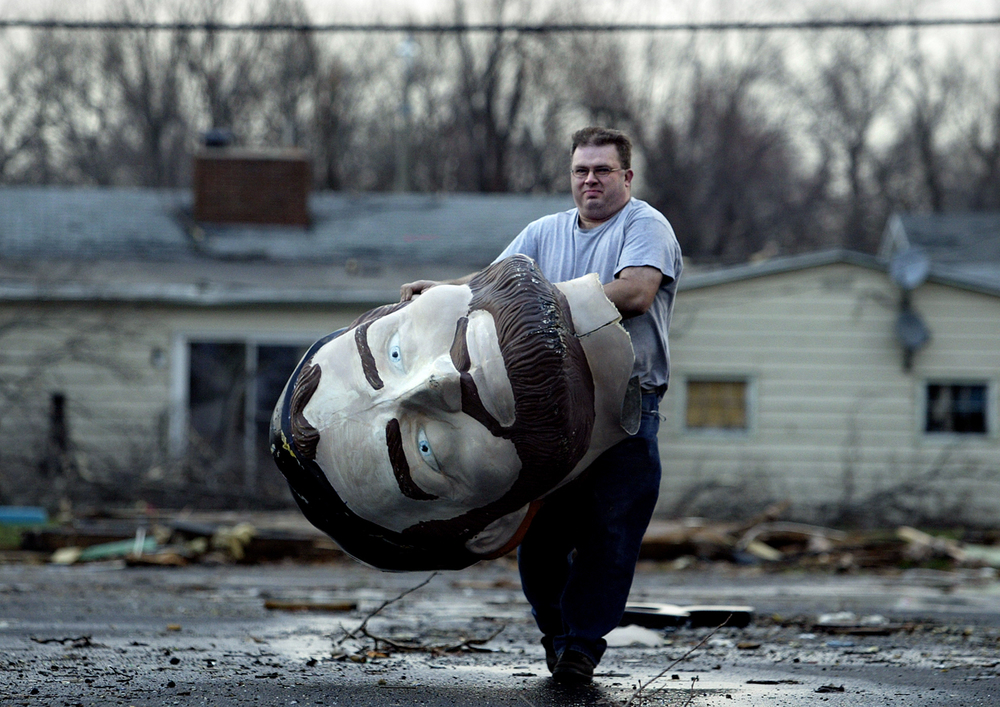 Gene Lanich returns the missing Paul Bunyan head to the Lauterbach Tire and Auto shop after finding it behind Benchmark Auto Sound on Wabash Avenue Monday morning March 13, 2006. File/Jonathan Kirshner/The State Journal-Register