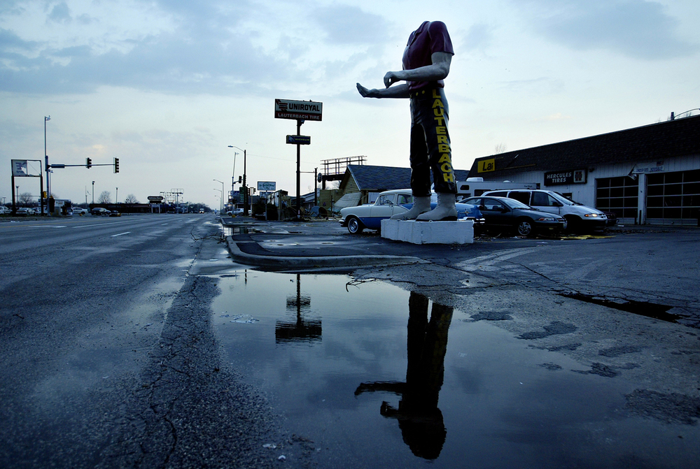 A headless Paul Bunyan statue stands over Wabash Avenue at daybreak on Monday, March 13, 2006. File/Jonathan Kirshner/The State Journal-Register